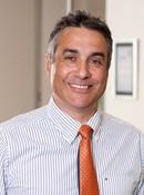 Dr. Simon  Andrade